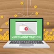 ilustraçao representando laptop com a frase video monetization em tela com moedas ao fundo