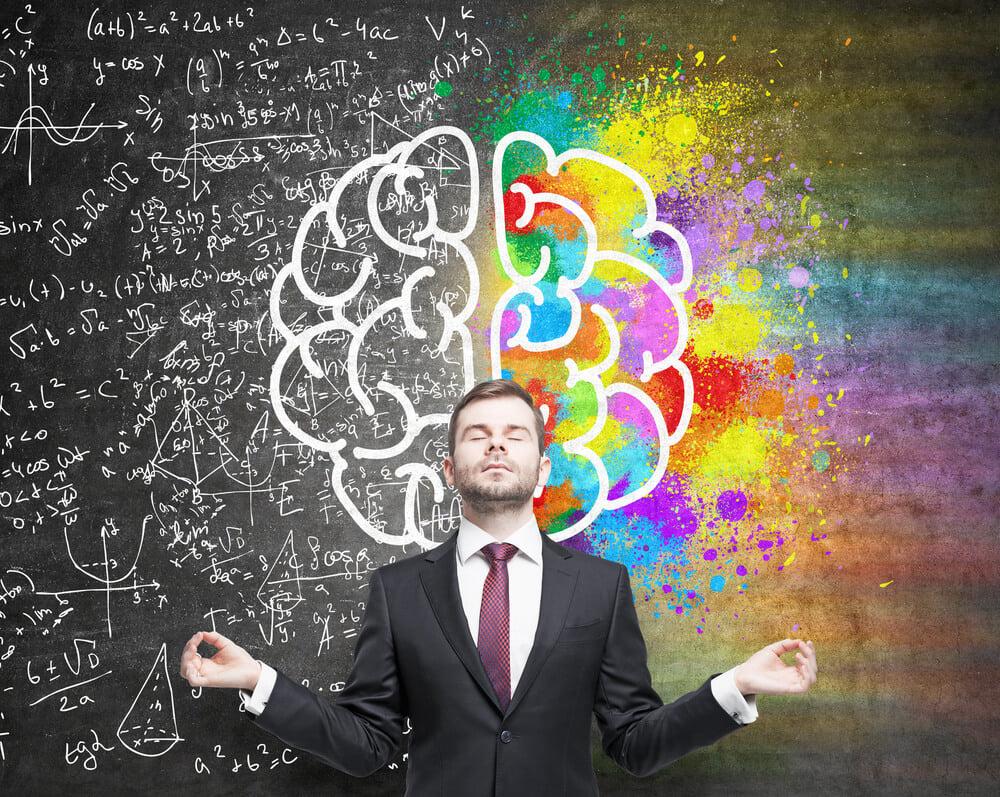 homem executivo em posição de meditação a frente de ilustração demonstrando equilibrio