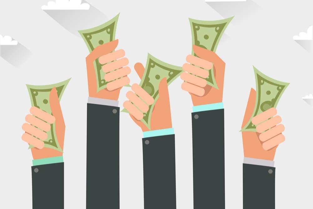 ilustração de mãos segurando cédulas de dinheiro