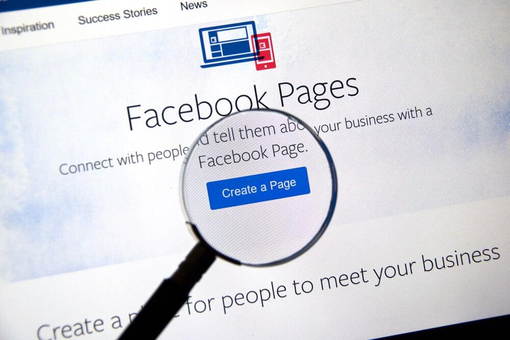 lupa no botão Criar página do site Facebook