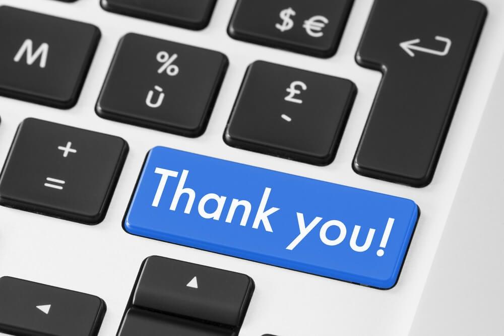 botão de teclado de laptop nomeada Thank you em agradecimento