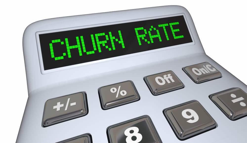 ilustração de calculadora com resultado demonstrado o título churn rate