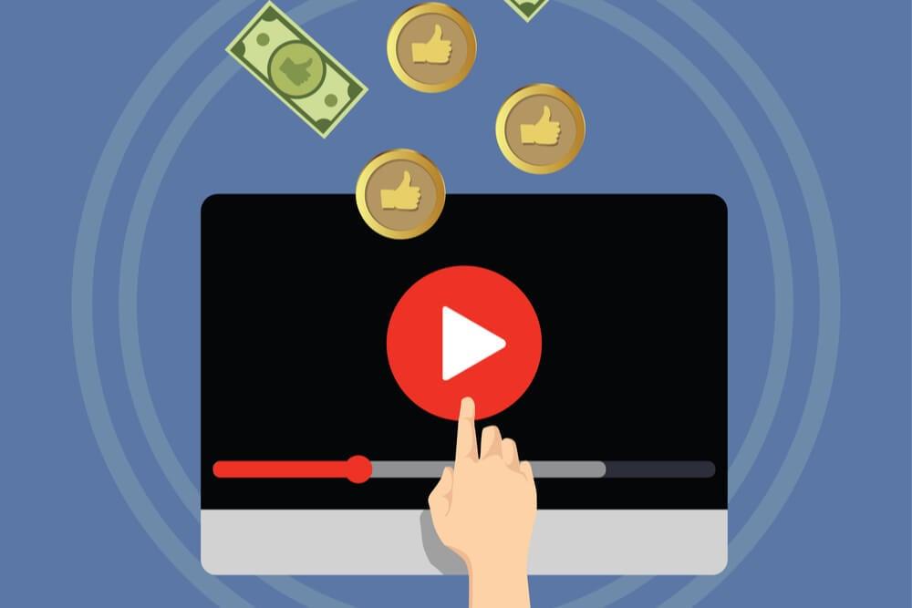 ilustraçao de computador com simbolo da plataforma youtube ao meio e moedas em sua volta