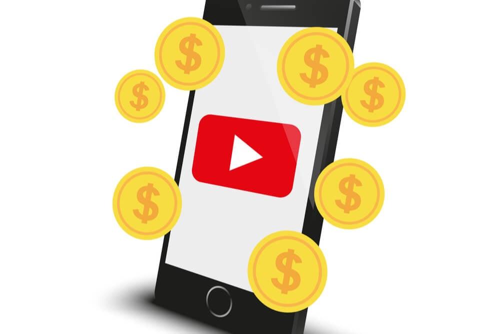 ilustraçao de smartphone com logo do aplicativo youtube em tela e simbolos de moedas em sua volta