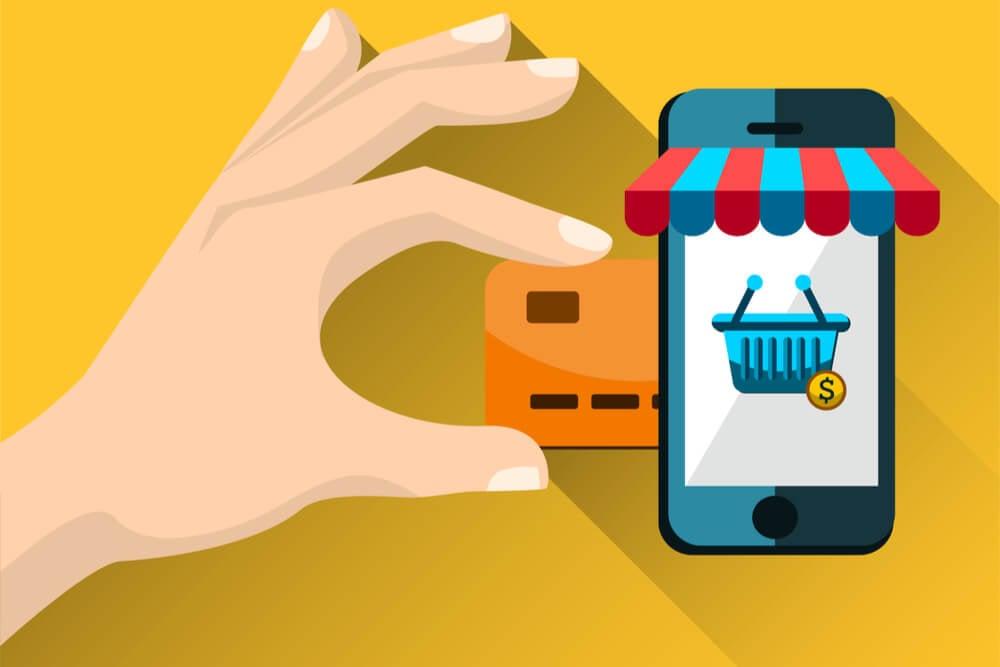ilustraçao de tela de smartphone mostrando cesta de compras e cartao de credito ao lado, simbolizando compras online