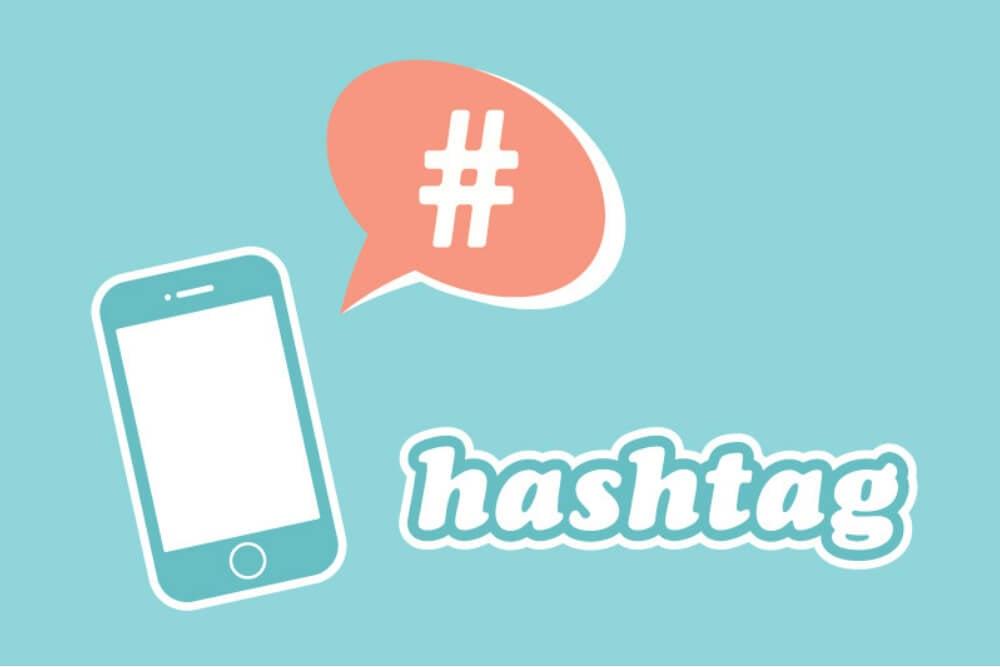 ilustração do título hashtag junto de smartphone e balão de comunicação