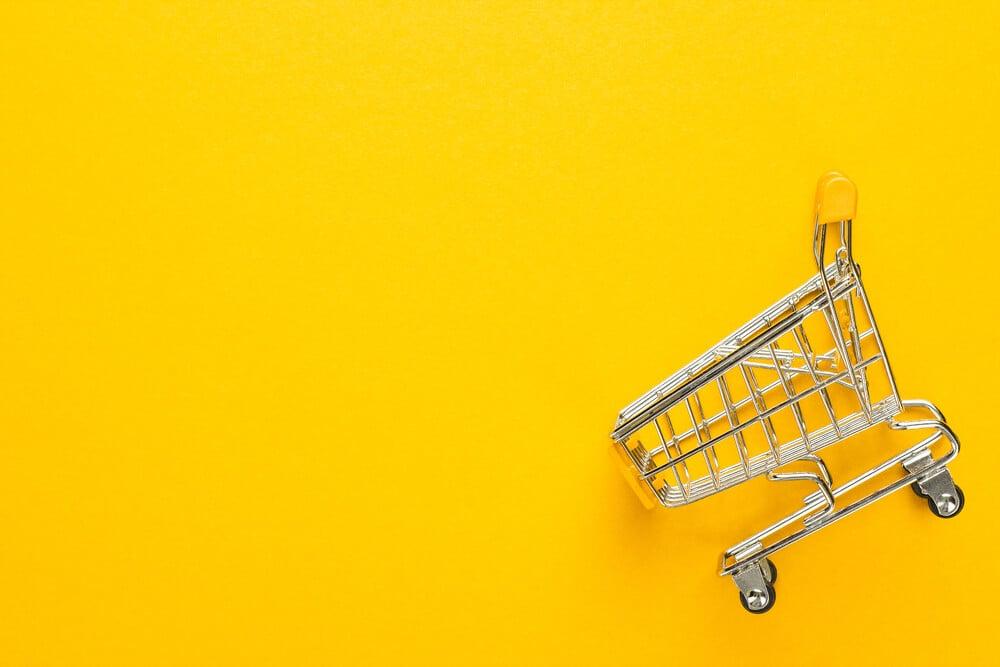 ilustraçao representando carrinho de compras em fundo amarelo