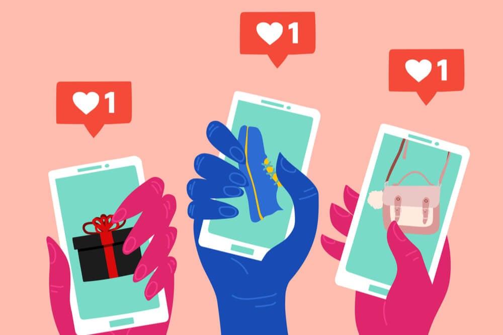 ilustraçao demonstrando maos segurando smartphones com simbolos de curtidas ao topo