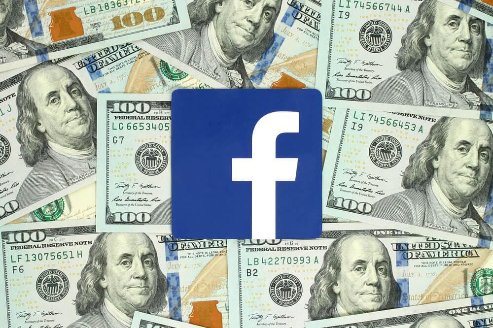 icone de aplicativo facebopok com notas de dinheiro ao fundo