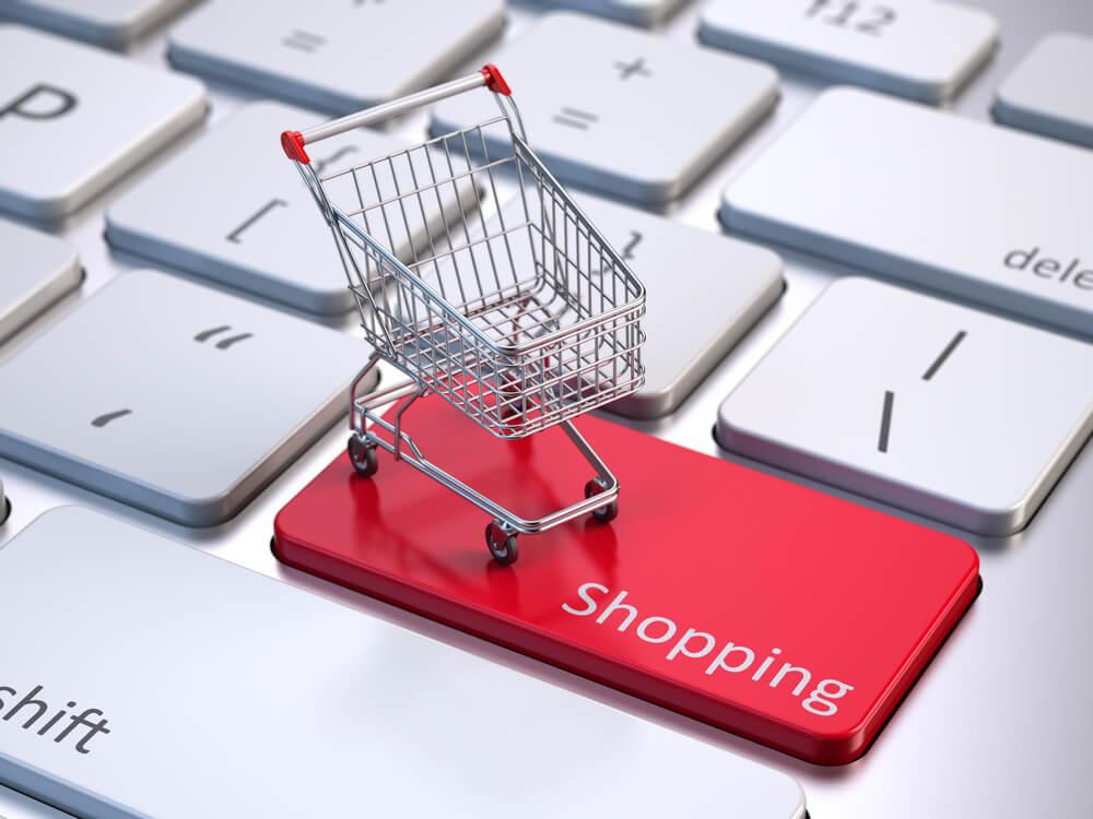 ilustraçao de carrinho de compras sob tecla de teclado com a palavra shopping