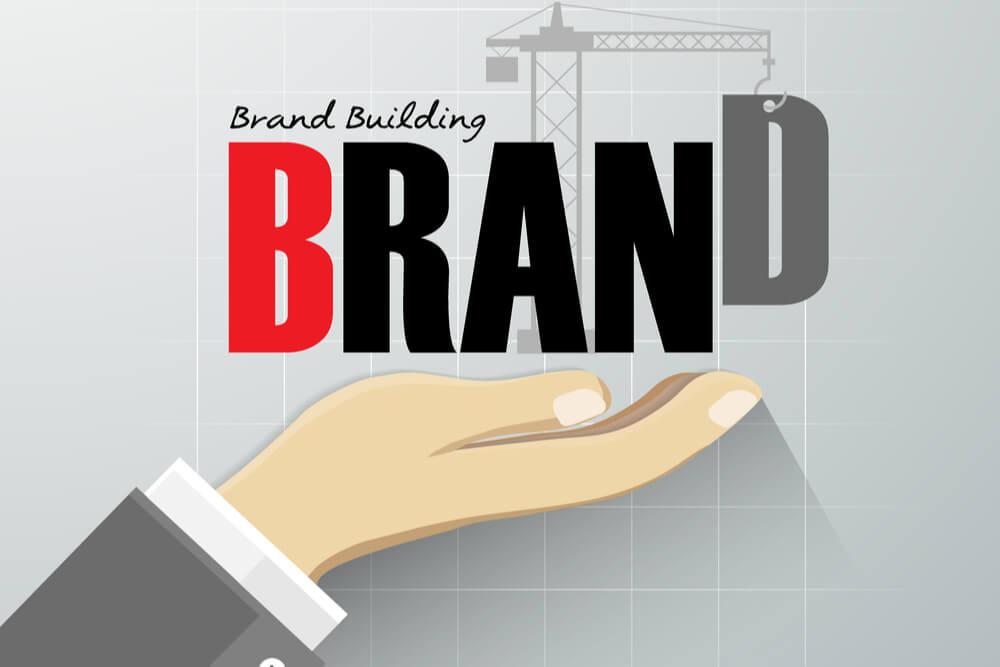 ilustraçao demonstrando mao executiva abaixo da frase brand bulding brand