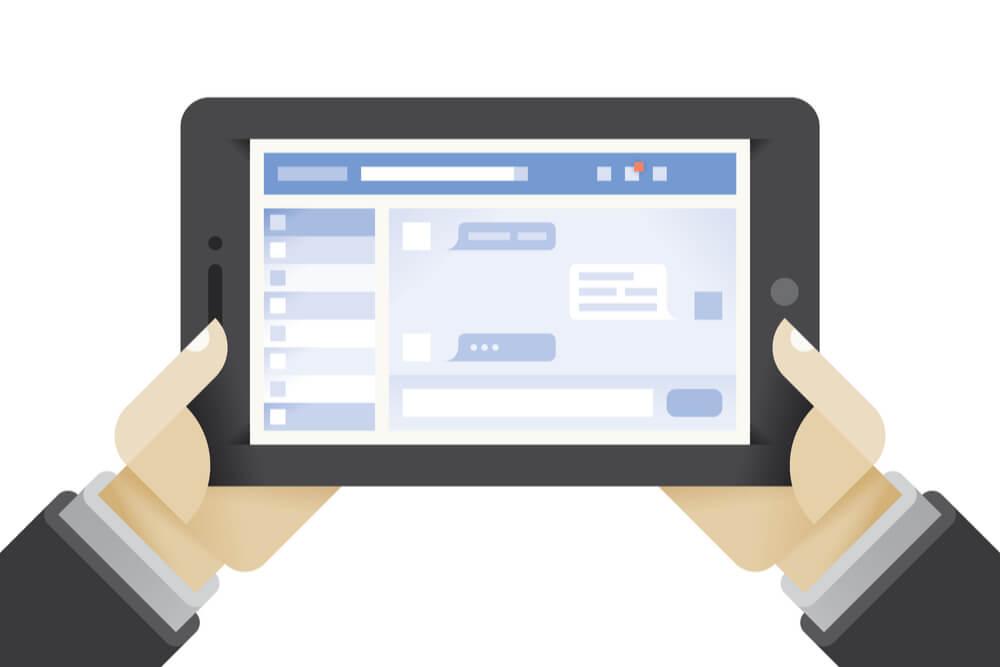 ilustraçao demonstrando maos segurando tablet com plataforma facebook em tela