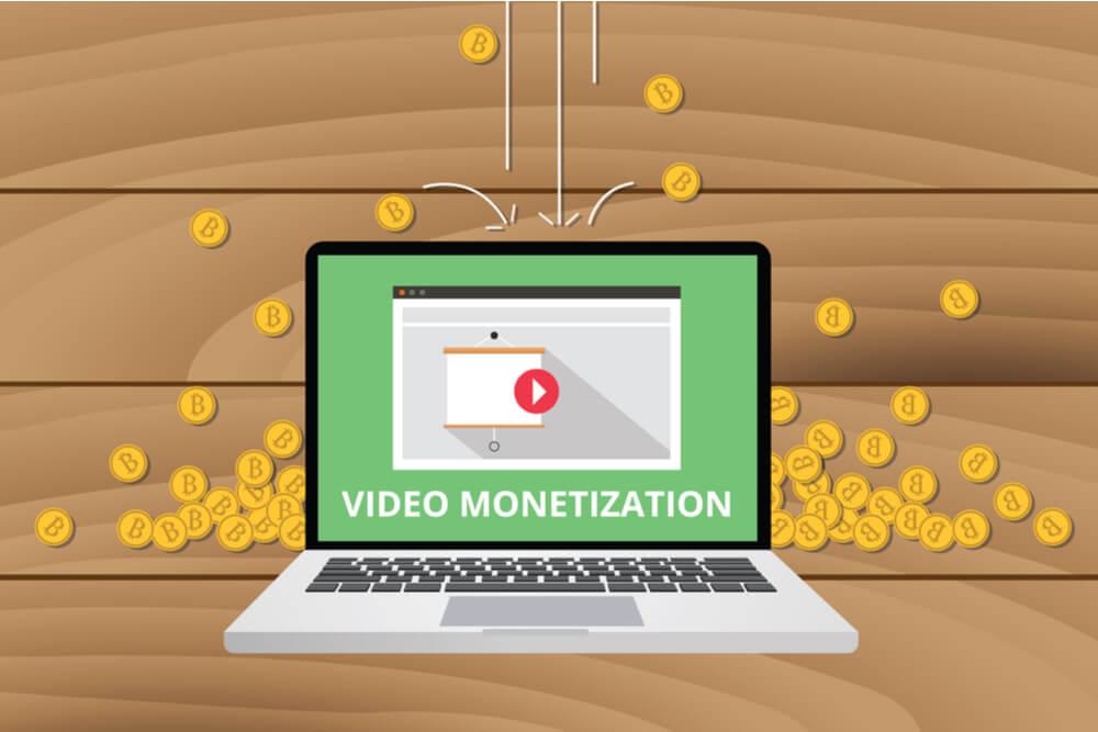 ilustraçao demonstrando laptop com simbolo de youtube em tela e moedas em volta